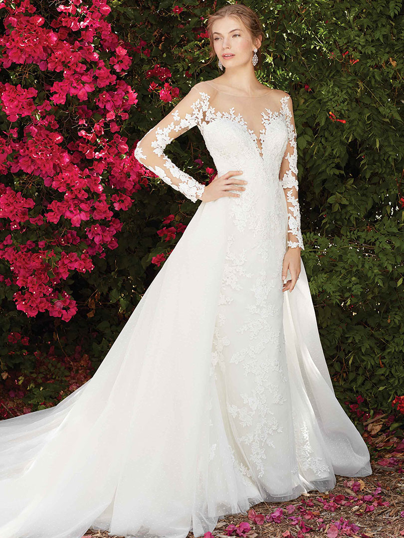 7ea18d21202f 2232L Tulip offers a more dainty look with visually striking floral lace  appliques that adorn the gown from the sleeves to the train.